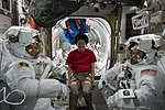 ISS-55 crew members during a spacesuit fit check in the Quest airlock.jpg