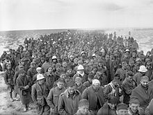 A column of thousands of ragged looking men, stretching all the way to the horizon