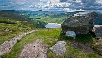 Wicklow Way - The J. B. Malone memorial at Barr Rock on the Wicklow Way overlooking Lough Tay.