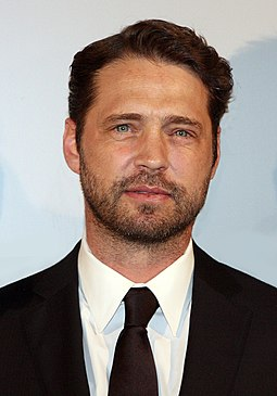 Jason Priestley (pictured in 2012), an actor whom Renna coached while the latter drove in the developmental Infiniti Pro Series. Jason Priestley 2012.jpg