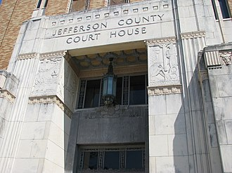 Matchett Herring Coe - Coe's reliefs at the Jefferson County Court House, Beaumont, Texas, 1931 (note cowskulls at right)