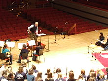 John Rutter conducting at rehearsals.jpg