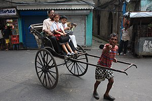 Transport in India - A human-pulled rickshaw in Kolkata