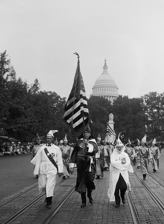 From commons.wikimedia.org: Ku Klux Klan parade7 {MID-239165}