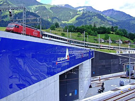 Entrance of the new Lotschberg Base Tunnel, the third-longest railway tunnel in the world, under the old Lotschberg railway line. It was the first completed tunnel of the greater project NRLA. Lotschberg Tunnel.jpg