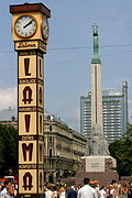 The Laima Clock with the Freedom Monument visible in the background