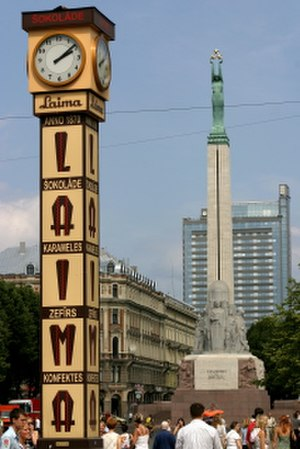 Laima (confectioner) - The Laima Clock with the Freedom Monument visible in the background