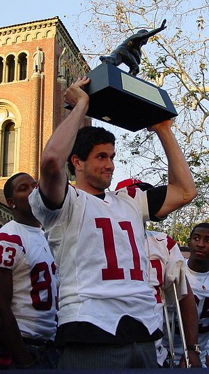 Leinart holding his Heisman trophy at USC's ch...