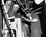 Leroy Gordon Cooper Junior and Warren North testing the gimbaling rig.jpg