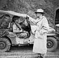 Lieutenant General Sir William Slim, commanding British Fourteenth Army in Burma, chatting with a Gurkha rifleman, November 1944. SE2952.jpg