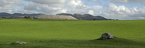 Listoghil - Listoghil from the north west with a small satellite tomb, tomb 52, in the foreground