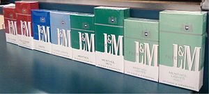Cigarette pack - Row of L&M cigarettes, illustrating US 'regular' and '100' lengths. Packages of fewer than 20 cigarettes are illegal to buy in the United States.