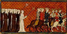 Miniature représentant Louis IX chevauchant parmi ses chevaliers, en train d'être bénis par des religieux.