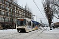 MAX train on Holladay St during Feb 2014 snowstorm.jpg
