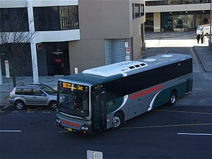Public transport in Canberra - Transborder Express Custom Coaches bodied Volvo B7R departing Jolimont Terminal
