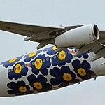 Maila Isola's 'Marimekko Unikko' flying on Finnair Airbus.jpg