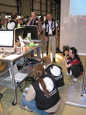 Various booth staffers, Wikimedia booth, Maker...
