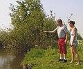Man gives instruction fly fishing.jpg