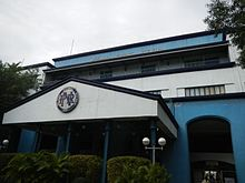 The facade of the station which is holding the old logo and the acronym at the top.