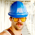 Manramp in shooting glasses and blue hardhat.png