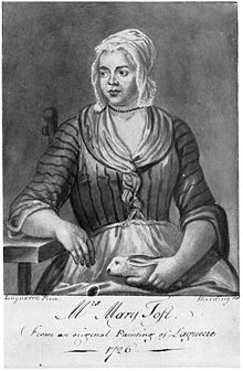 A engraving based on a painting of a young woman in poor clothing and a bonnet, sitting on a chair, holding a rabbit in her lap.  Her right elbow is supported by a table as she looks to the left, a neutral expression on her face.