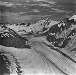 McCarty Glacier, tidewater glacier junction, hanging glaciers on the surrounding mountains with icefall, September 4, 1977 (GLACIERS 6628).jpg