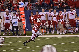 Melvin Gordon - Gordon during a 56-yard touchdown run in the 2012 Big Ten Football Championship Game