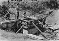Men installing permanent drop-inlet dam - NARA - 286166.tif