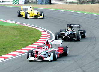 A1 Team New Zealand - Halliday chases Team Mexico at Brands Hatch.