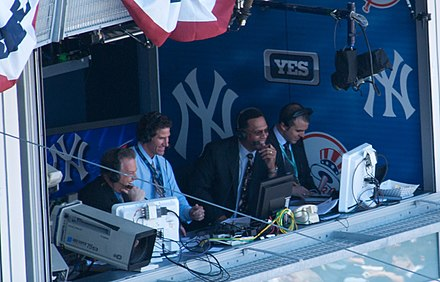 Announcers Michael Kay, Paul O'Neill, Ken Singleton, and Ryan Ruocco in the YES Network broadcast booth at Yankee Stadium in 2009 Michael Kay, Paul O'Neill, Ken Singleton in broadcast booth.jpg