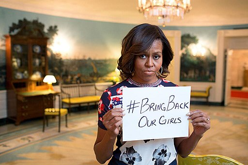 Michelle Obama holds up the #BringBackOurGirls sign