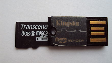 A Kingston card reader which accepts Micro SD memory cards (Transcend card shown partially inserted), and acts as a USB flash drive; resulting size is approximately 2 cm in length, 1 cm in width, and 2 mm in thickness. MicroSDFDrive.JPG