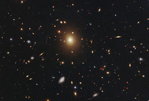 George O. Abell - Abell 2261 is one galaxy cluster from his catalogue of clusters of galaxies, collected during the National Geographic Society - Palomar Observatory Sky Survey.