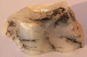 Lustre (mineralogy) - Moss opal