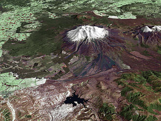 Mount Ruapehu - A composite satellite image looking west across Ruapehu, with the older eroded volcano Hauhungatahi visible behind it, and the cone of Ngauruhoe visible to the right.
