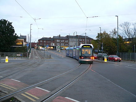 Nottingham Express Transit in the UK uses a 750 V DC overhead, in common with most modern tram systems.