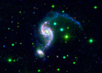 NGC 2536 - A multiwavelength image of NGC 2535 and NGC 2536. Mid-infrared emission is red, H alpha emission (at 694.0 nm) is green, and ultraviolet emission is blue.