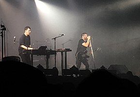 Atticus Ross (left) and Trent Reznor (right) performing in October 2018