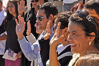 Immigration to the United States - Immigrants to the United States take the Oath of Allegiance at a naturalization ceremony at the Grand Canyon National Park in Arizona, September 2010.