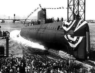 The launching ceremony of the USS Nautilus January 1954. In 1958 it would become the first vessel to reach the North Pole. Nautiluscore.jpg