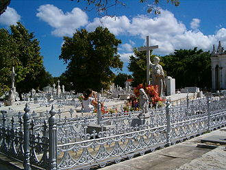 José Vilalta Saavedra - Grave of La Milagrosa in Colon Cemetery with worshipers leaving flowers and praying. Sculpture by Villalta Saavedra.