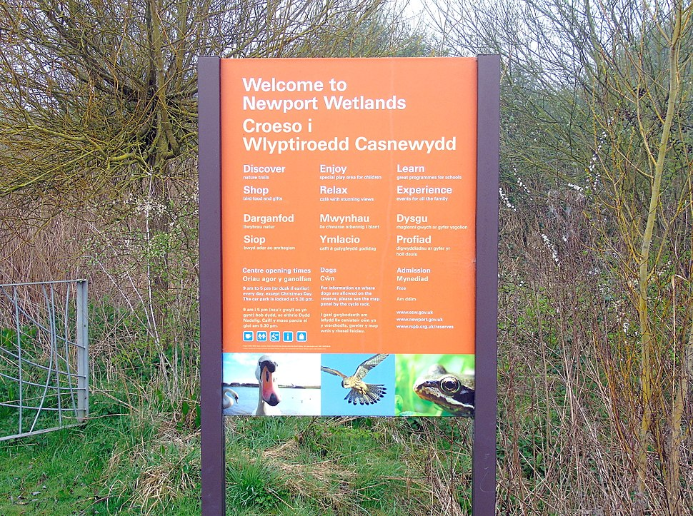 Newport Wetlands RSPB Nature Reserve Visitors Centre Sign Outside Car Park in English and Welsh