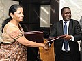 Nirmala Sitharaman and the Minister for Industry, Trade and Investment, Tanzania, Mr. Charles John Mwijage exchanging after signing the mutually agreed document.jpg