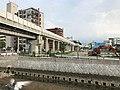 Nishitetsu Kaizuka Line and Kashiigawa River.jpg