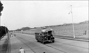Hussain Sagar - A view of NSR bus on Tank Bund road c. 1932