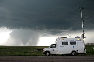 VORTEX projects - VORTEX2 field command vehicle with tornado in sight. Wyoming, LaGrange. 2009