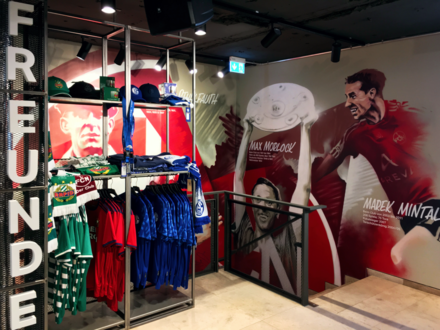 Friendship corner in the Fan Shop of the 1. FC Nurnberg with trikots of Schalke 04. Nuernberg Clubhaus 02.png