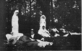 Nurses with their patients in the park at Chateau Ognon. Miss Jane McKee, who won the Croix de Guerre, at left; Miss Eastham, at right. (1918).png