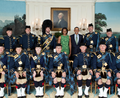 Obama with the Air Force Pipe Band.png