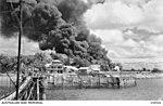 Oil tanks on Stokes Hill burning during the first Japanese air raid, Feb 1942.JPG